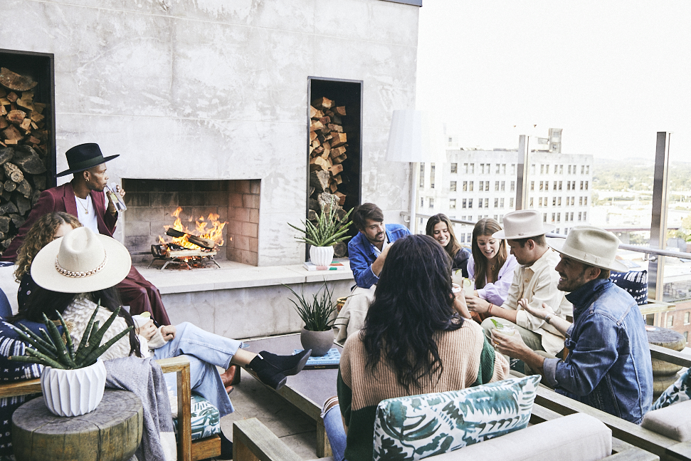 A group of friends around a fireplace