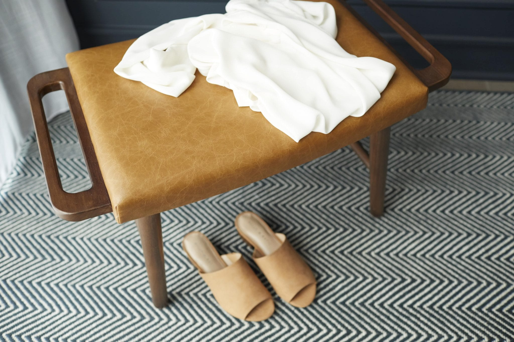 Room Detail, Shoes and Shirt on Ottoman