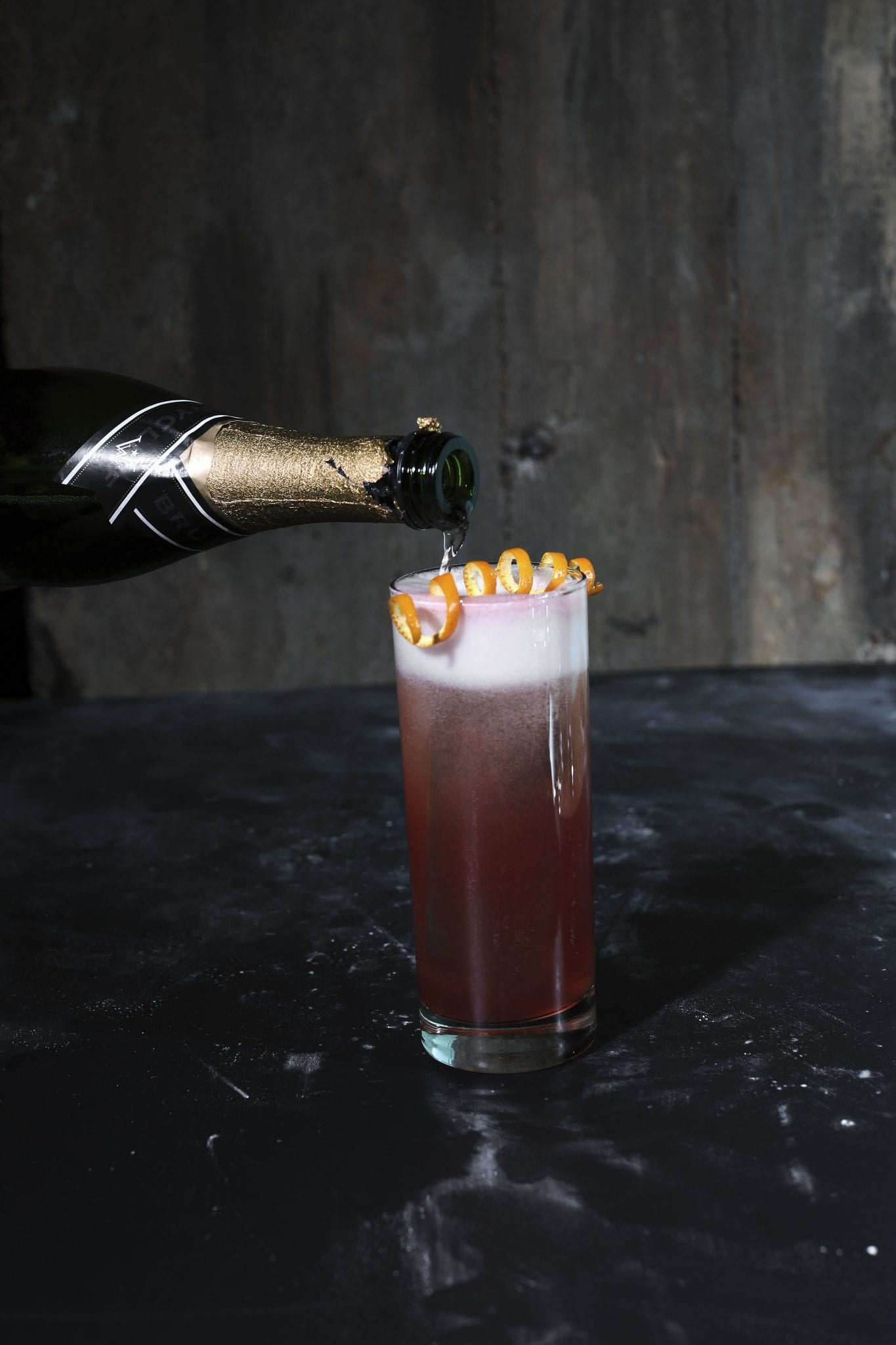 Champagne being poured into a cocktail