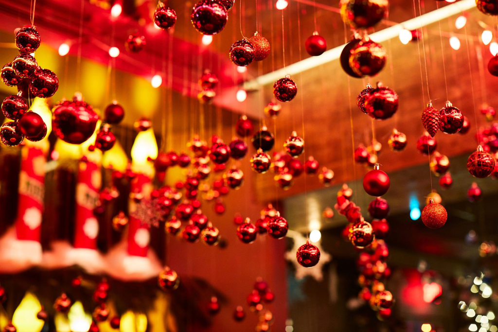 Red ornaments hanging from ceiling