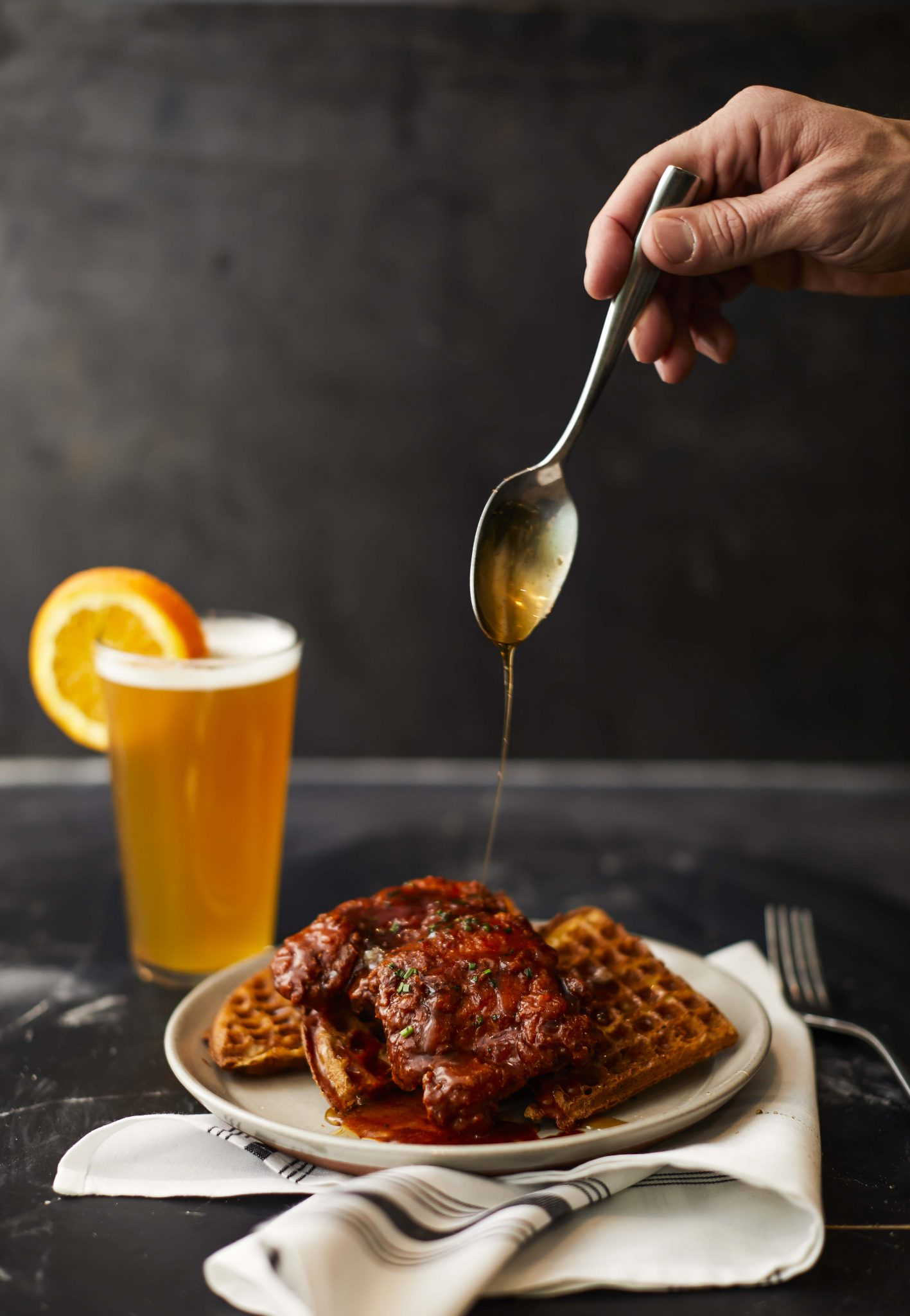 Drizzling Honey on Chicken & Waffles from Makeready L&L