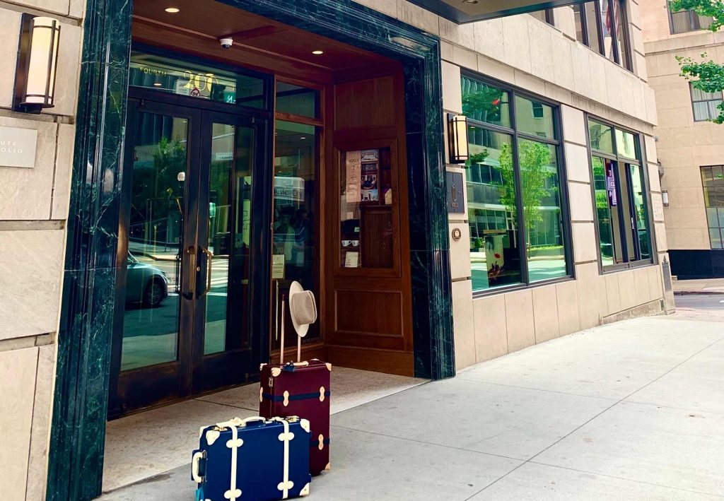 Vintage suitcases outside of Noelle entrance